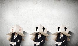 Business people wearing boxes Royalty Free Stock Photo