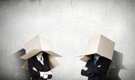 Business people wearing boxes Stock Image