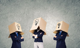 Business people wearing boxes Royalty Free Stock Images