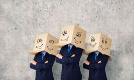 Business people wearing boxes Royalty Free Stock Photos