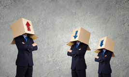 Business people wearing boxes Stock Photography
