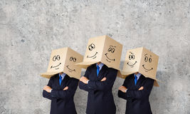 Business people wearing boxes Royalty Free Stock Photography