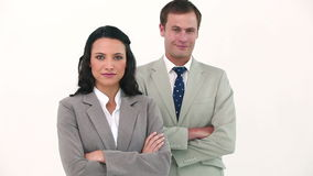 Business people wearing headset posing. Against white background stock footage