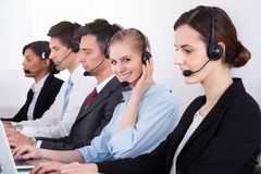 Business people wearing headset working in office Stock Images