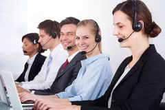 Business people wearing headset working in office Royalty Free Stock Image