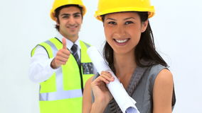 Business people wearing safety helmet. Against white background stock video