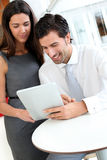Business people websurfing on tablet Stock Photos