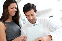 Business people websurfing on tablet Royalty Free Stock Images