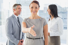 Business people welcoming new staff Royalty Free Stock Images