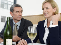 Business People With Wineglass And Bottle In Restaurant Stock Photography