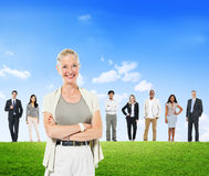 Business People and a Woman in Front Standing Outdoors Royalty Free Stock Photography