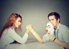 Business people woman and man arm wrestling royalty free stock photography