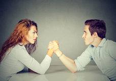 Business people woman and man arm wrestling Stock Images