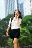 Business people - woman on smart phone, Hong Kong Stock Images
