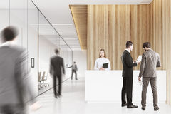 Business people in a wooden office Royalty Free Stock Photos