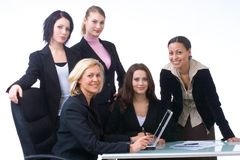 Business people at work. Businessteam working together on a notebook Stock Image