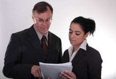Business people at work. Business peoiple looking at working documents royalty free stock photos