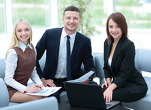 Business people at work. Business people in formalwear looking a. T camera and smiling Royalty Free Stock Photos
