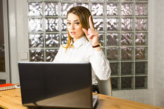 Business, people and work idea concept - businesswoman pointing finger up in office Stock Photo