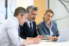 Business people in a work meeting with laptop Stock Photo