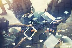 Business people work together with laptop and tablet. Concept of teamwork and startup. Double exposure. Business people work in office with laptop and tablet stock photo
