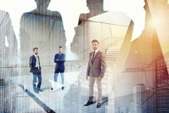 Businessmen that work together in office. Concept of teamwork and partnership stock images