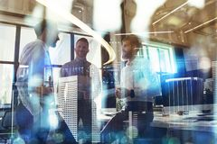 Business people work together in office. Concept of teamwork and partnership. double exposure with modern city and light stock images