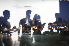 Business people work together in office. Concept of teamwork and partnership. double exposure. Business people work together in office during the night. Concept royalty free illustration