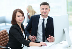 Business people at work. Two business people in formalwear looki Royalty Free Stock Photo