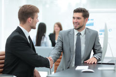 Business people at work. Two business people in formalwear shaki Royalty Free Stock Photography