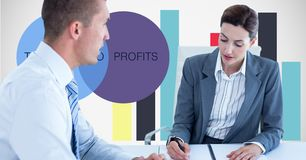 Business people working against graphs. Digital composite of Business people working against graphs Royalty Free Stock Image