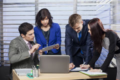 Business people working as a team. At the office Stock Photo
