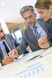 Business people working on budget Stock Photo