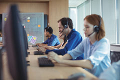Business people working at call center Stock Image