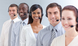 Business people working in a call center in a line Stock Images
