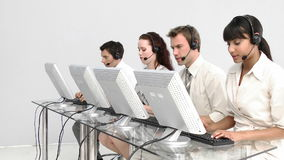 Business people working in a call centre Stock Images