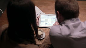 Business people working with charts on tablet stock footage