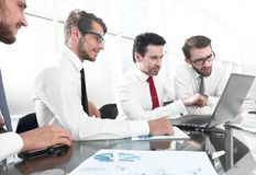 Business people working and communicating while sitting at the office desk stock images