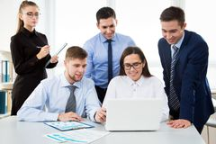 Business people working in an office. Business people working with computer in an office Stock Images