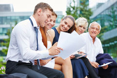 Business people working on contract outdoors Stock Photo