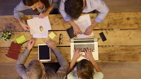 Business people working on desk stock footage
