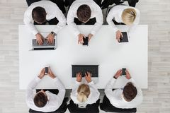 Business people working with digital devices royalty free stock photos