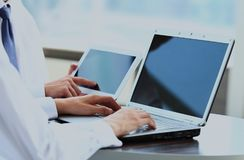 Laptop with a blank screen useful for composition. Business people working with digital tablet and laptop Stock Image