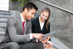 Business people working on a digital tablet Stock Photo