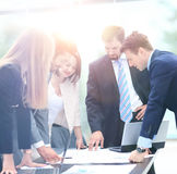 Business people working and discussing together at meeting in of Stock Photo