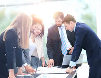 Business people working and discussing together at meeting in of Royalty Free Stock Photos