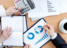 Business people working with documents royalty free stock image