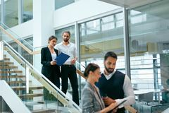 Business People In Working Environment. Team Of Man And Woman Working In Business Office Center. High Resolution royalty free stock photography
