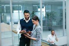 Business People In Working Environment. Team Of Man And Woman Working In Business Office Center. High Resolution stock image