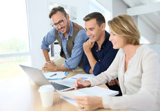 Business people working on financial strategy Royalty Free Stock Image